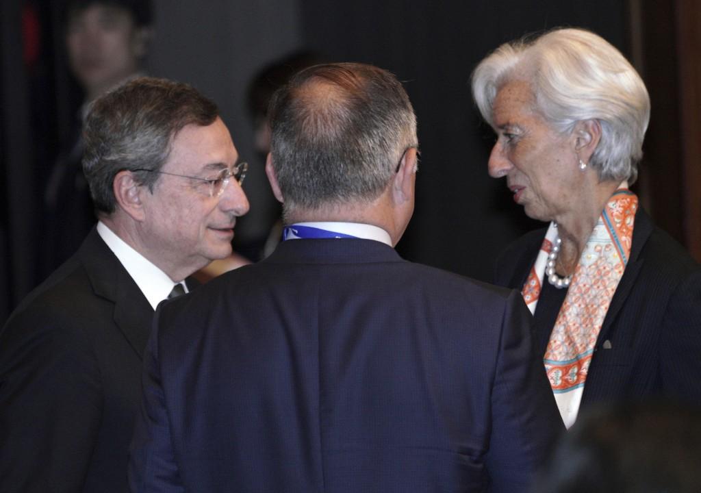 International Monetary Fund (IMF) Managing Director Christine Lagarde, right, and European Central Bank (ECB) President Mario Draghi, left, speak prio