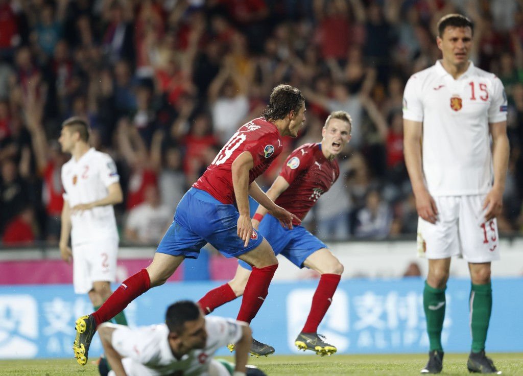 Czech Republic's Patrick Schick, left, runs to celebrate after scoring his sides second goal during the Euro 2020 group A qualifying soccer match betw...