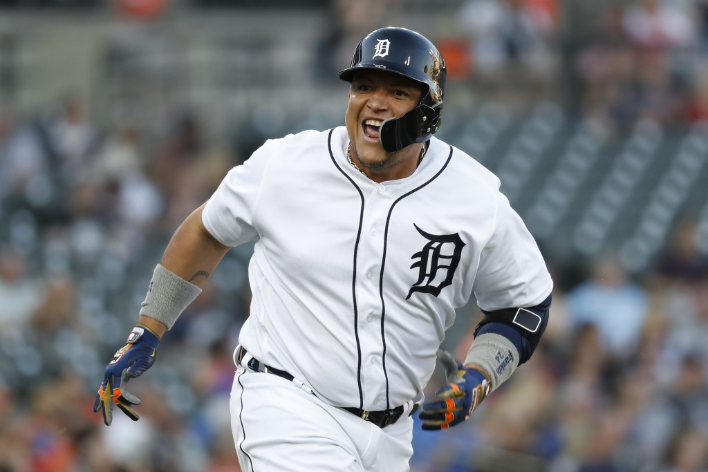 Detroit Tigers' Miguel Cabrera reacts to hitting a...