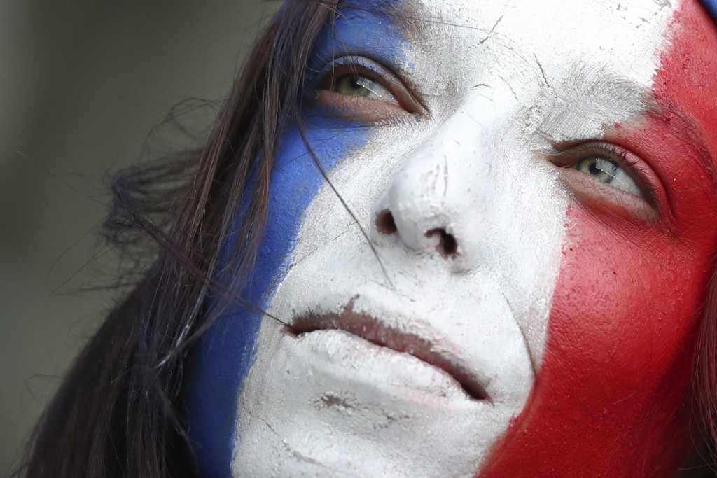 A French soccer fan waits for the start of the Group A soccer match between France and South Korea on the occasion of the Women's World Cup at the Par...