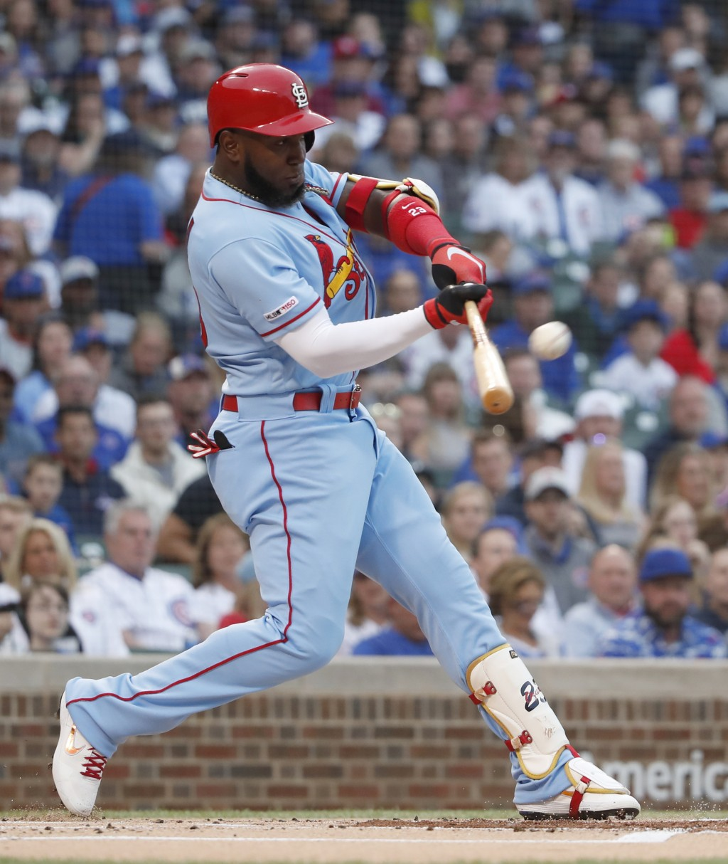 St. Louis Cardinals' Marcell Ozuna hits a three-run home run against the Chicago Cubs during the first inning of a baseball game Saturday, June 8, 201...