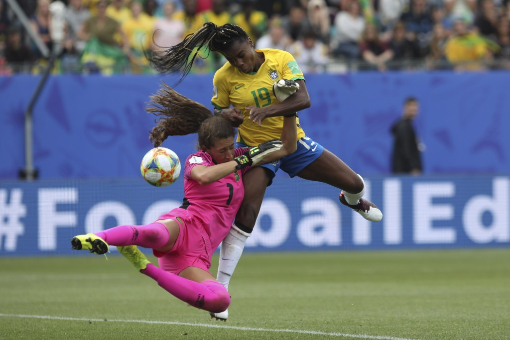 Jamaica goalkeeper Sydney Schneider, left, and Brazil's Ludmila go for the ball during the Women's World Cup Group C soccer match between Brazil and J