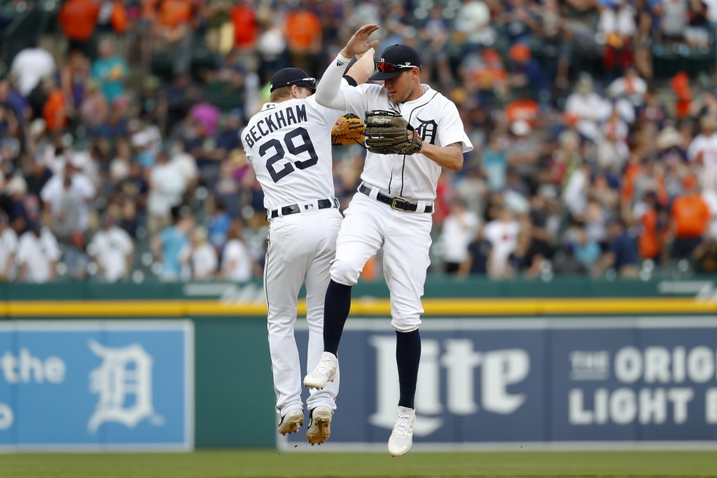 Detroit Tigers' JaCoby Jones, and Gordon Beckham (29) celebrate after the final out in the ninth inning of a baseball game against the Minnesota Twins