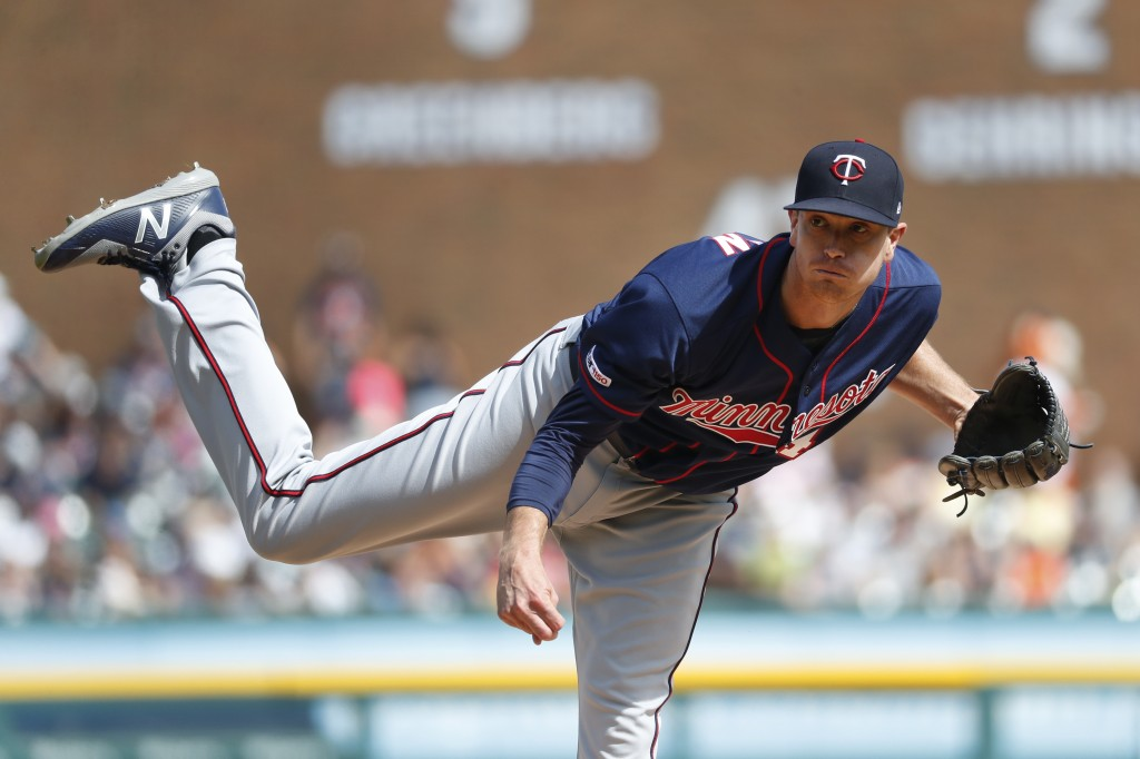 Minnesota Twins pitcher Kyle Gibson throws against the Detroit Tigers in the first inning of a baseball game in Detroit, Saturday, June 8, 2019. (AP P...