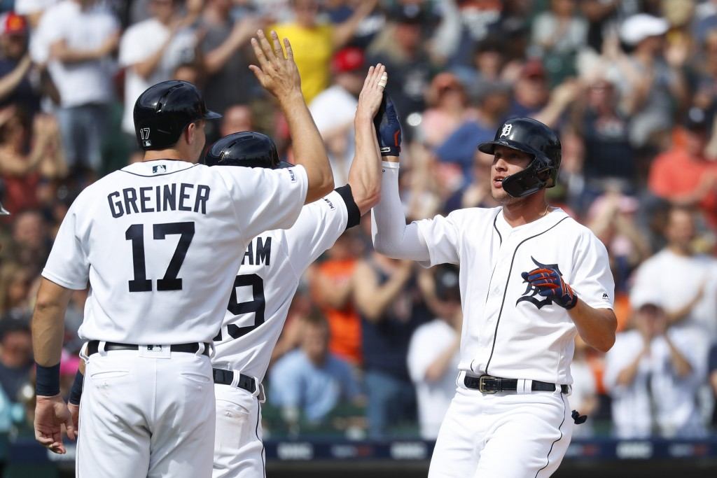 Detroit Tigers' JaCoby Jones, right, celebrates his three-run home run with Grayson Greiner (17) and Gordon Beckham (29) during the second inning of a
