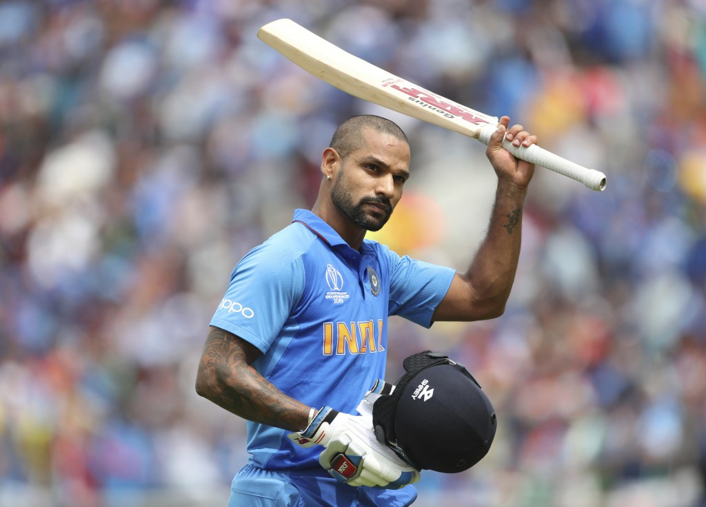 India's Shikhar Dhawan acknowledges the applause from the crowd as he leaves the field after losing his wicket during the Cricket World Cup match betw...