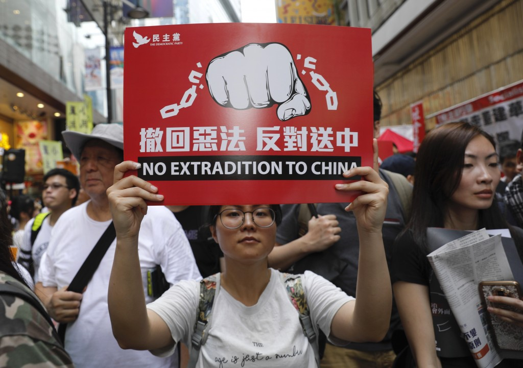 Protesters march in a rally against the proposed amendments to extradition law in Hong Kong, Sunday, June 9, 2019. The amendments have been widely cri...