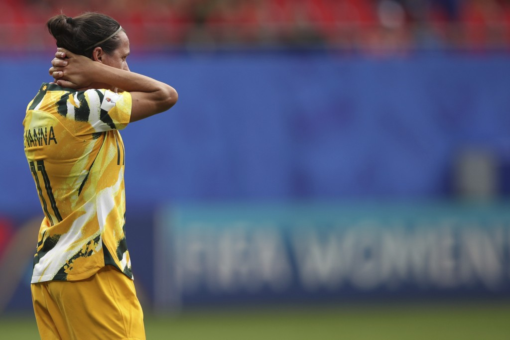 Australia's Lisa De Vanna holds her head after the Women's World Cup Group C soccer match between Australia and Italy at the Stade du Hainaut in Valen