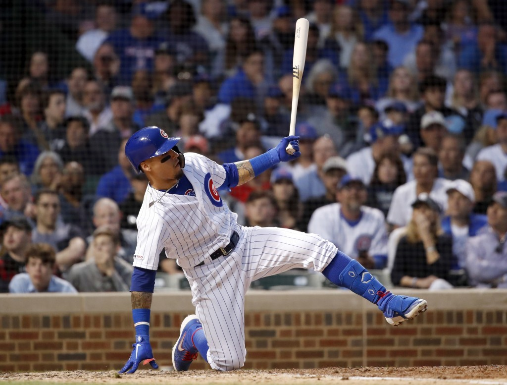 Chicago Cubs' Javier Baez falls in the batter's box during the fifth inning of a baseball game against the St. Louis Cardinals, Saturday, June 8, 2019