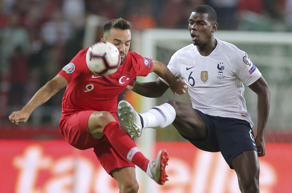 Turkey's forward Kenan Karaman, left, is challenged by France's midfielder Paul Pogba during the Euro 2020 Group H qualifying soccer match between Tur