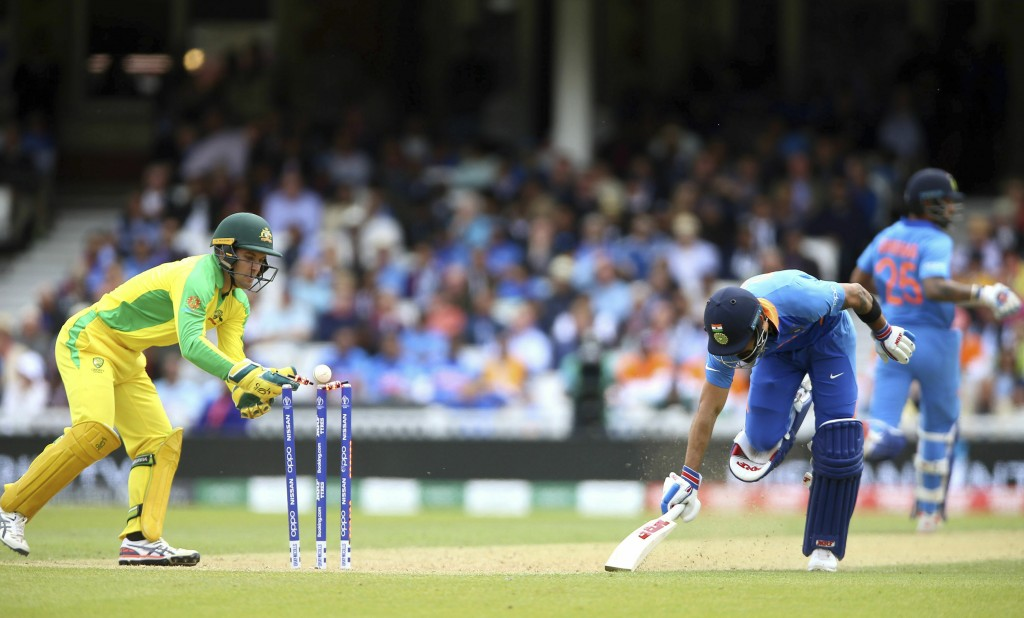 India's Virat Kohli survives a run out appeal against Australia's wicketkeeper Alex Carey during the Cricket World Cup group stage match at The Oval i