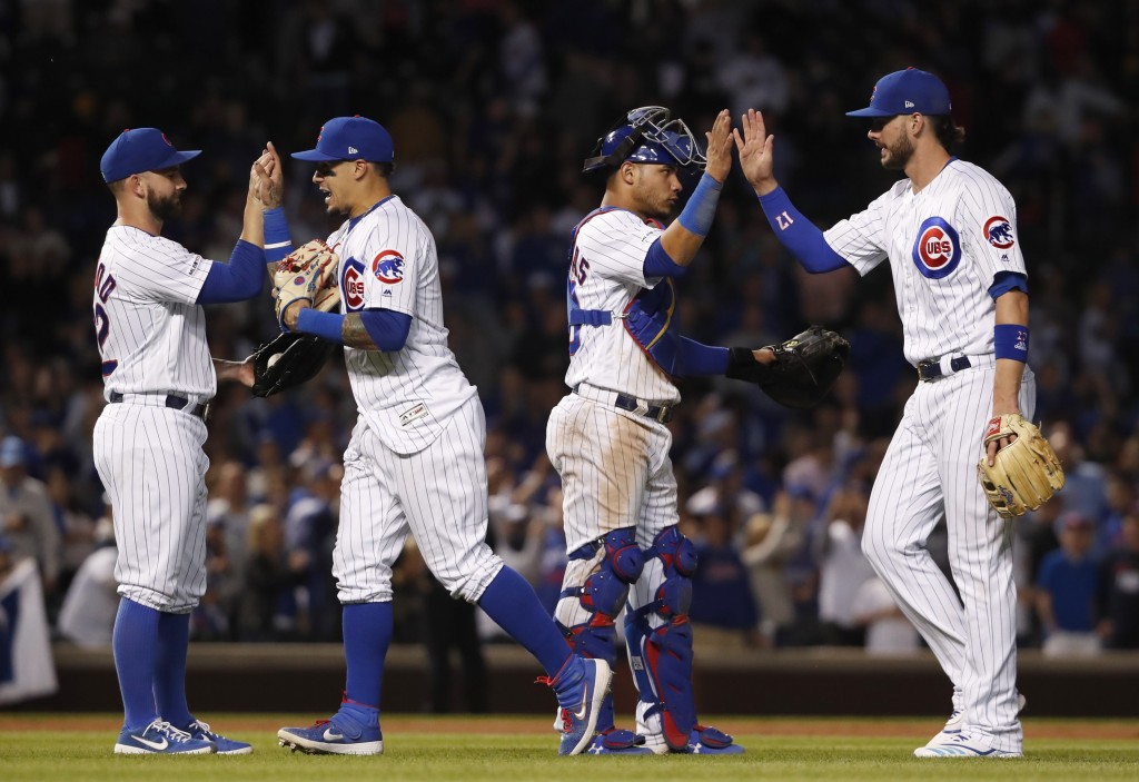 The Chicago Cubs celebrate after defeating the St. Louis Cardinals during baseball game Saturday, June 8, 2019, in Chicago. AP Photo/Jeff Haynes)