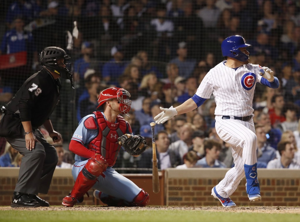 Chicago Cubs' Victor Caratini, right, watches his three-RBI double during the sixth inning of a baseball game as St. Louis Cardinals catcher Matt Wiet...