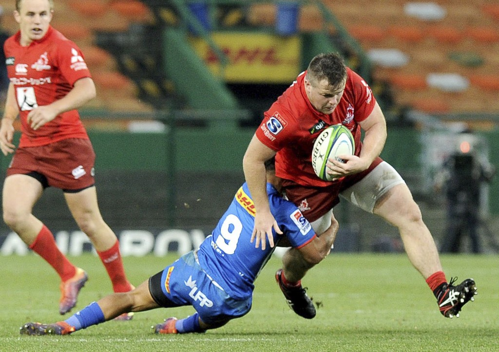 Sunwolves' Conan O'Donnell is tackled by Stormers'...