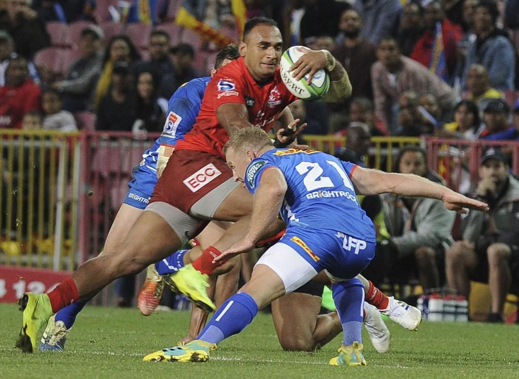 Sunwolves' Semisi Masirewa, centre vies for the ball with Stormers' Jano Vermaak during their Super Rugby match in Cape Town, South Africa, Saturday,