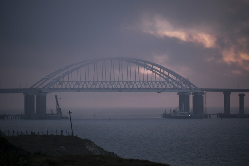 FILE - In this Monday, Nov. 26, 2018 file photo, the Kerch Bridge spans the opening for the passage of ships, near Kerch, Crimea. Russia has urged an ...