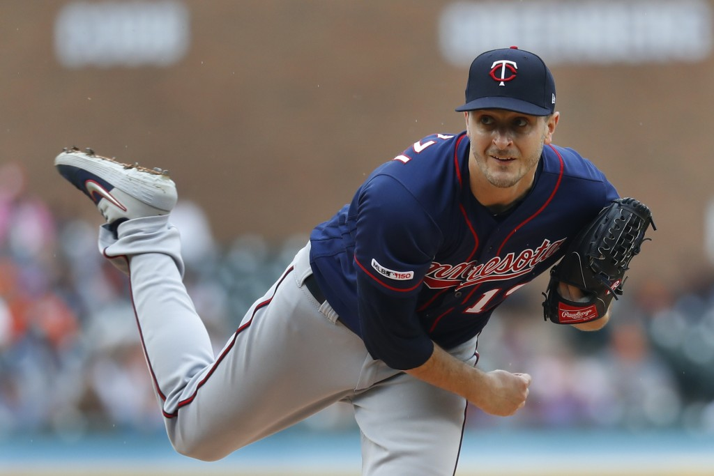 Minnesota Twins pitcher Jake Odorizzi throws against the Detroit Tigers in the first inning of a baseball game in Detroit, Sunday, June 9, 2019. (AP P...