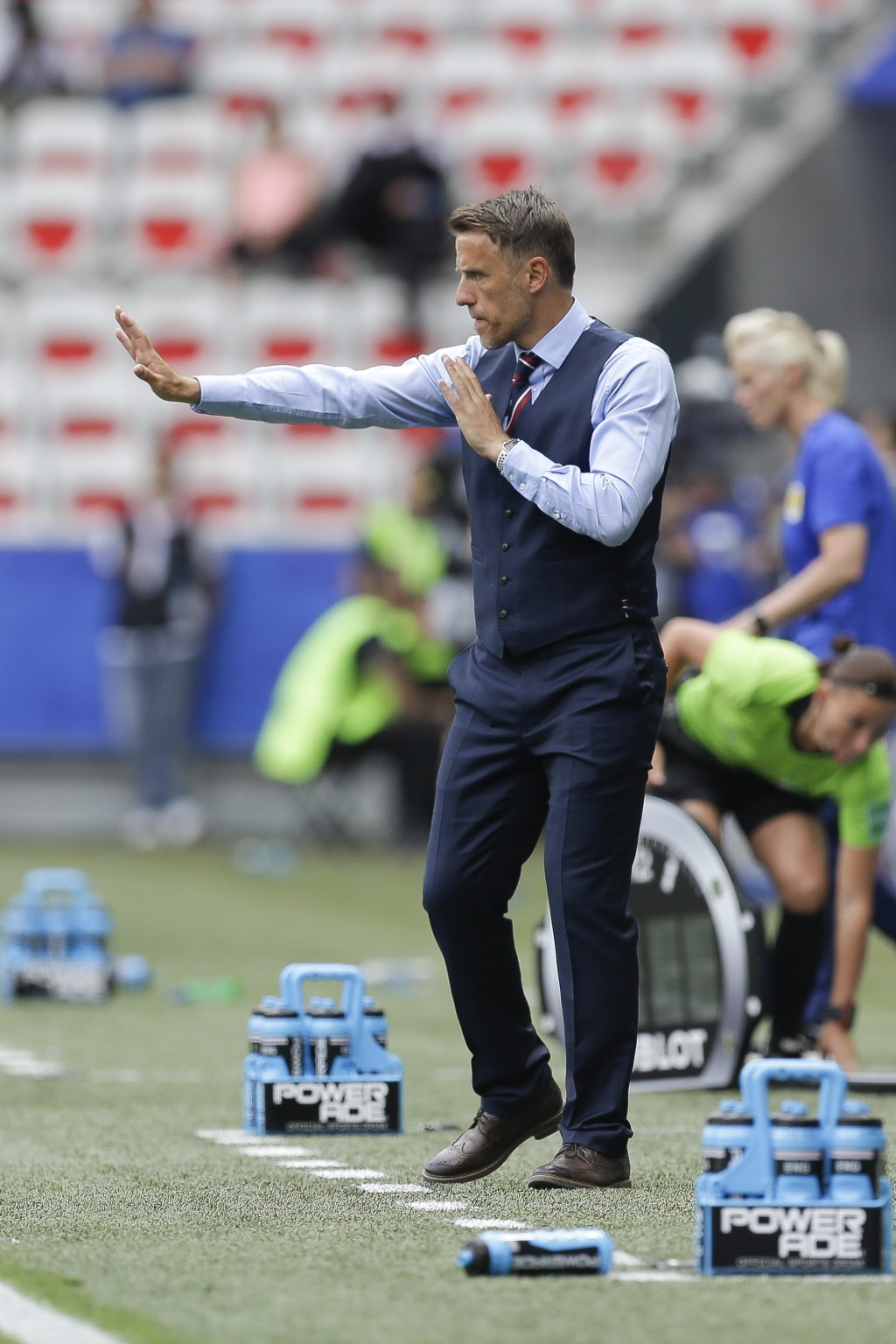 England head coach Philip Neville gives direction to the players during the Women's World Cup Group D soccer match between England and Scotland in Nic