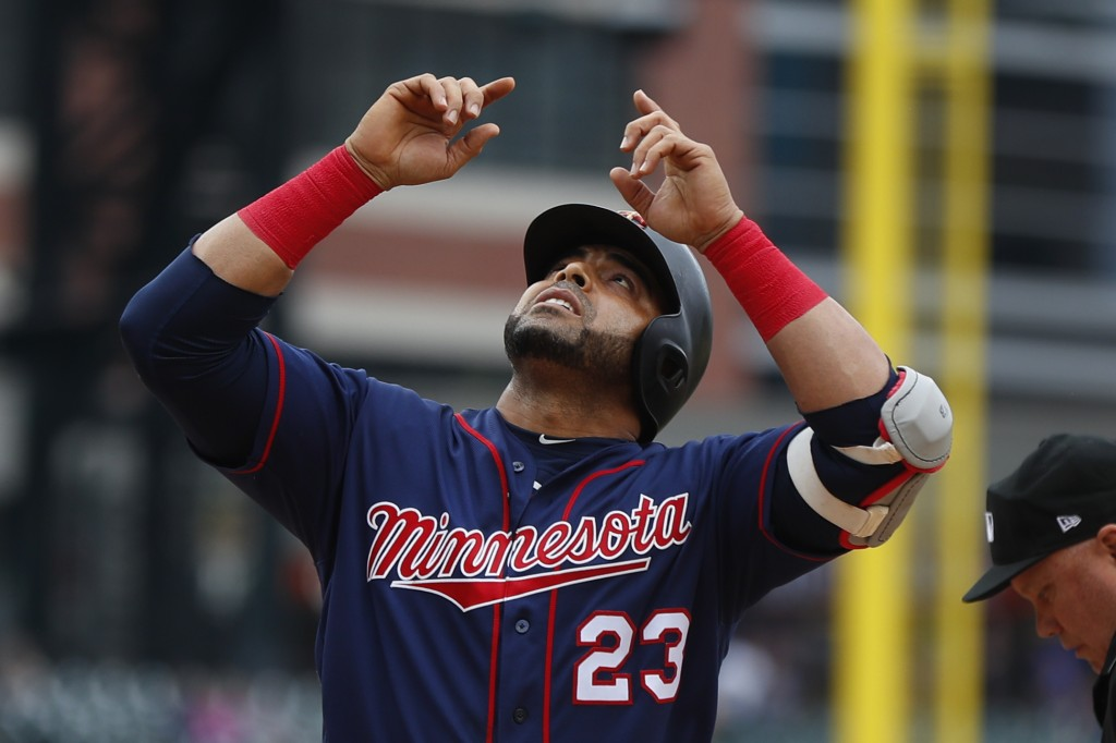 Minnesota Twins' Nelson Cruz celebrates his two-run home run against the Detroit Tigers in the first inning of a baseball game in Detroit, Sunday, Jun...