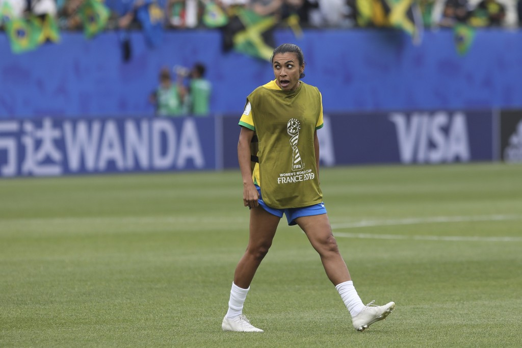 Brazil's Marta celebrates at the end of the Women's World Cup Group C soccer match between Brazil and Jamaica in Grenoble, France, Sunday, June 9, 201