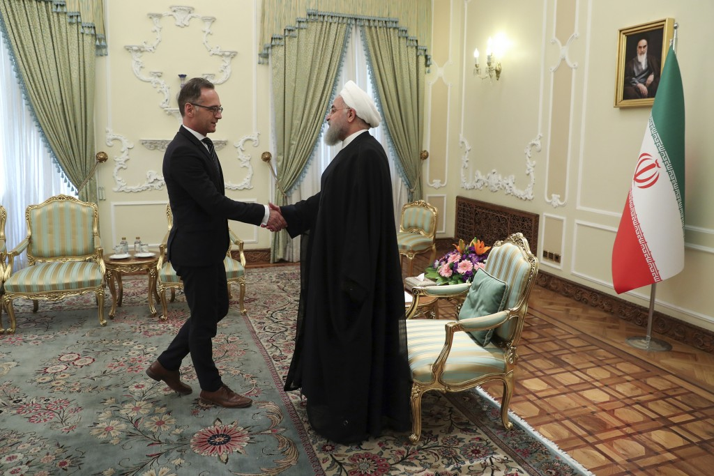 In this photo released by the official website of the office of the Iranian Presidency, President Hassan Rouhani, right, welcomes German Foreign Minis...
