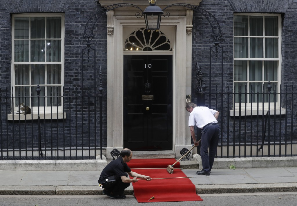 FILE - In this June 4, 2019 file photo, the red carpet is rolled out outside 10 Downing Streets before the arrival of President Donald Trump in centra
