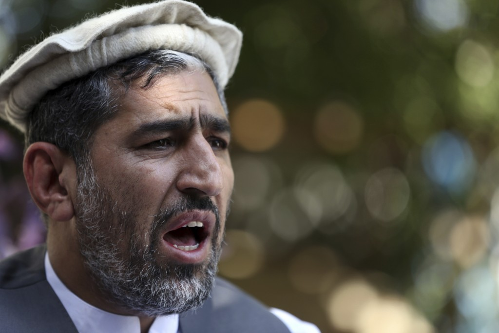 In this Thursday, May 30, 2019 photo, Ajmal Omar a member of the Nangarhar provincial council speaks during an interview with The Associated Press in