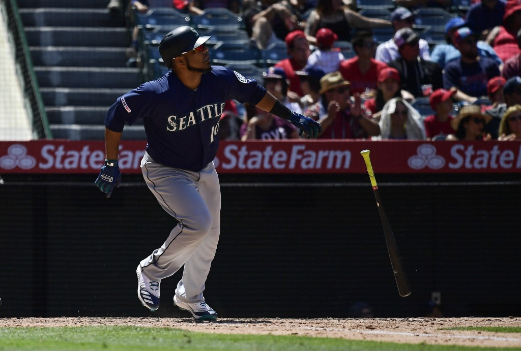Seattle Mariners' Edwin Encarnacion drops hit bat after hitting a solo home run during the sixth inning of a baseball game against the Los Angeles Ang