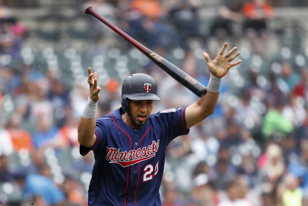 Minnesota Twins' Eddie Rosario tosses his bat after hitting a one-run single in the fourth inning of a baseball game in Detroit, Sunday, June 9, 2019....