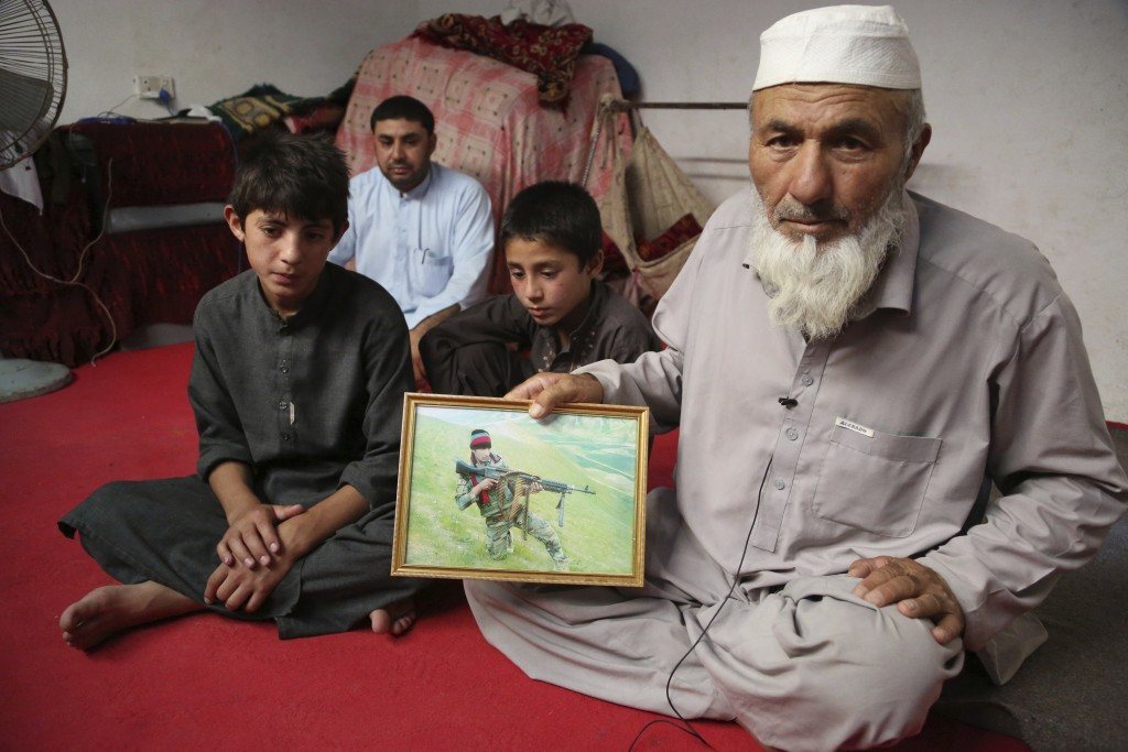 In this Thursday, May 30, 2019 photo, Noor Mohammad, who fled his village in Nangarhar in late April as Islamic State group fighters swept through the