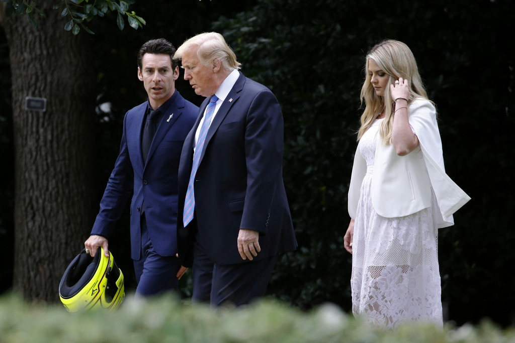 President Donald Trump walks with driver Simon Pagenaud, left, and Pagenaud's fiancee, Hailey McDermott, to the South Lawn at the White House, Monday,