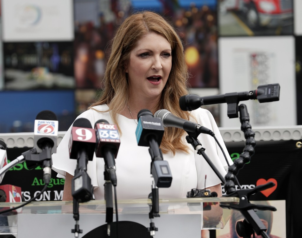 Barbara Poma, left, CEO of the onePulse foundation speaks during a news conference to introduce legislation that would designate the Pulse nightclub s