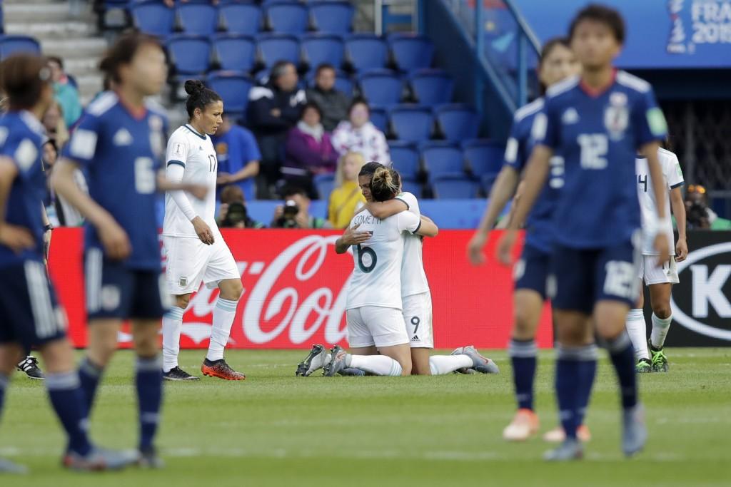 Argentina's Sole Jaimes, right, hugs teammate Alda...