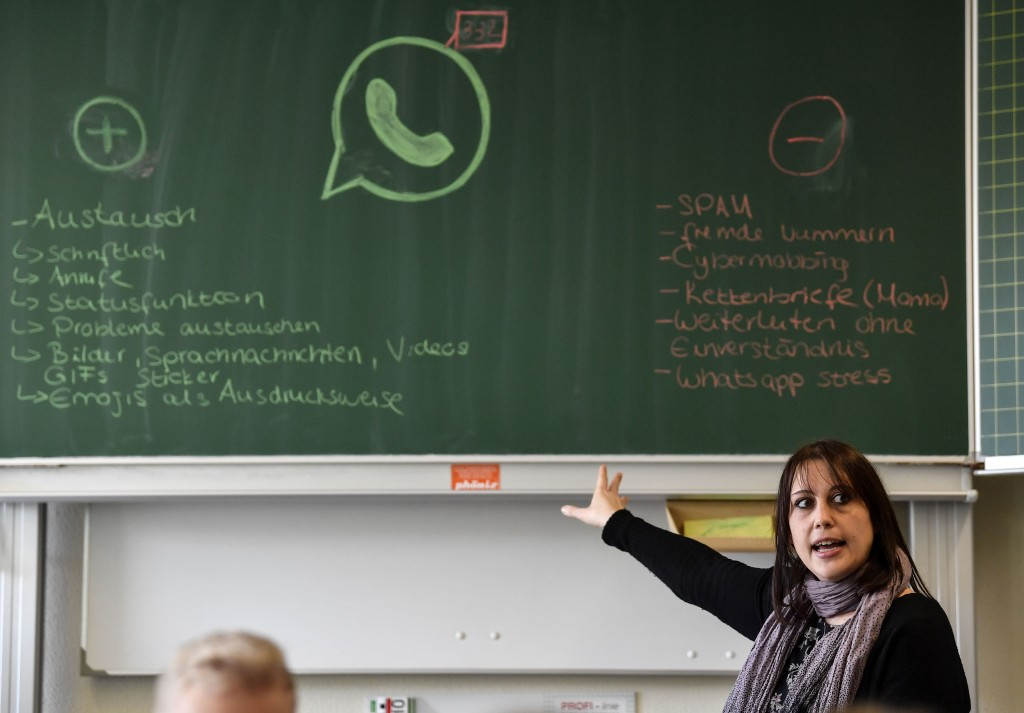 Teacher Vera Servaty talks to pupils during a lesson in social media and internet, at a comprehensive school in Essen, Germany, Monday, March 18, 2019...