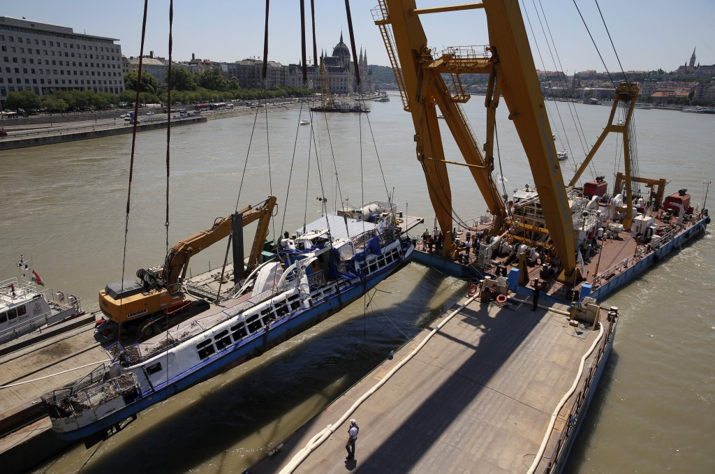 A crane lifts the sightseeing boat out of the Danube river in Budapest, Hungary, Tuesday, June 11, 2019. Eight people are still missing from the May 2