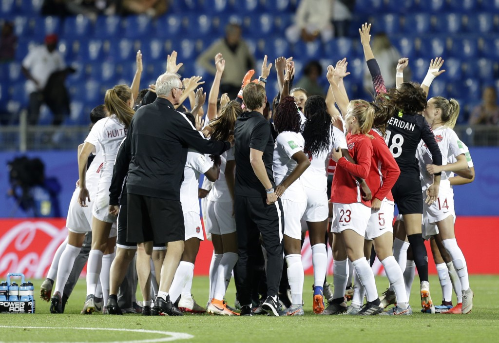 Canadian team celebrate after their 1-0 win in the...