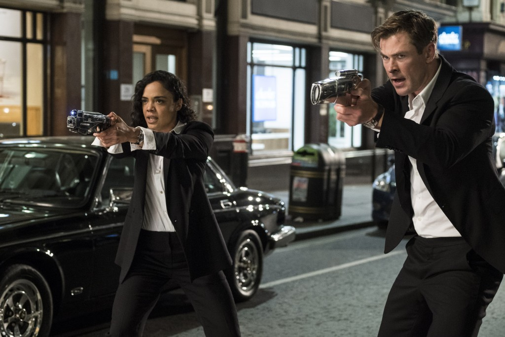 "This image released by Sony Pictures shows Tessa Thompson and Chris Hemsworth in a scene from Columbia Pictures' ""Men in Black: International."" (Giles..."