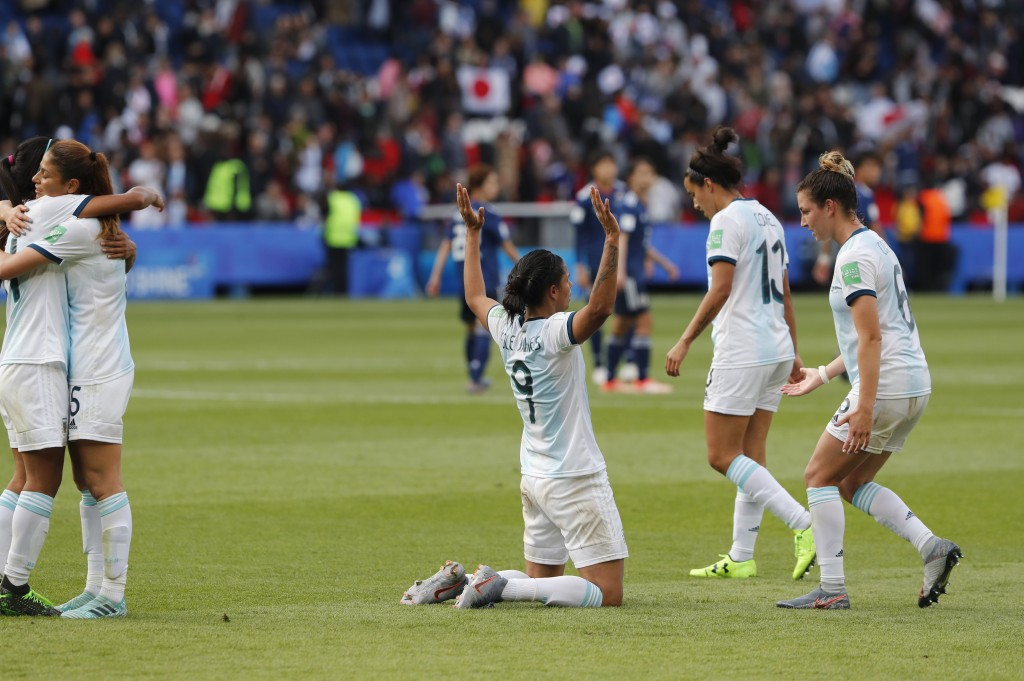 Argentina players react at the end Women's World Cup Group D soccer match between Argentina and Japan at the Parc des Princes in Paris, France, Monday