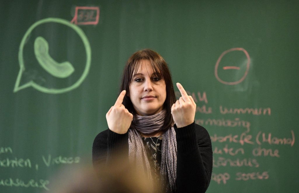 Teacher Vera Servaty reacts to pupils during a lesson in social media and internet at a comprehensive school in Essen, Germany, Monday, March 18, 2019...
