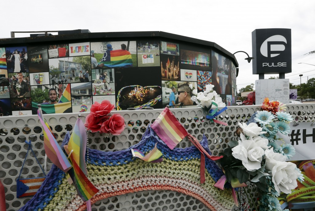 An outside view of the Pulse nightclub temporary memorial is seen before a news conference to introduce legislation that would designate the Pulse nig...