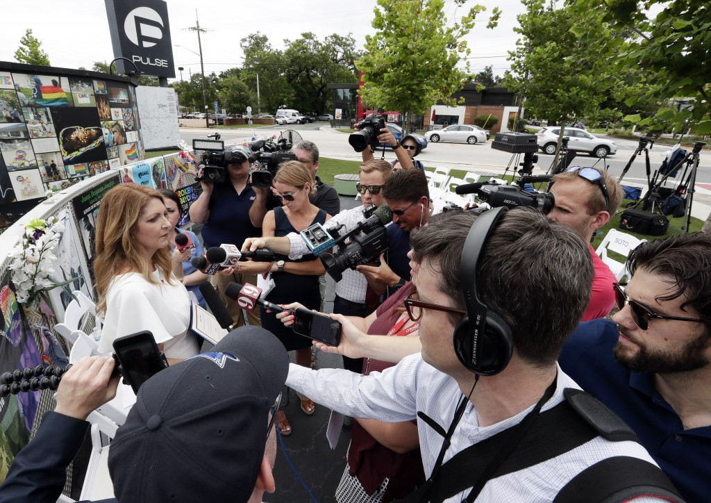 Barbara Poma, left, CEO of the onePulse foundation speaks during a news conference to introduce legislation that would designate the Pulse nightclub s...
