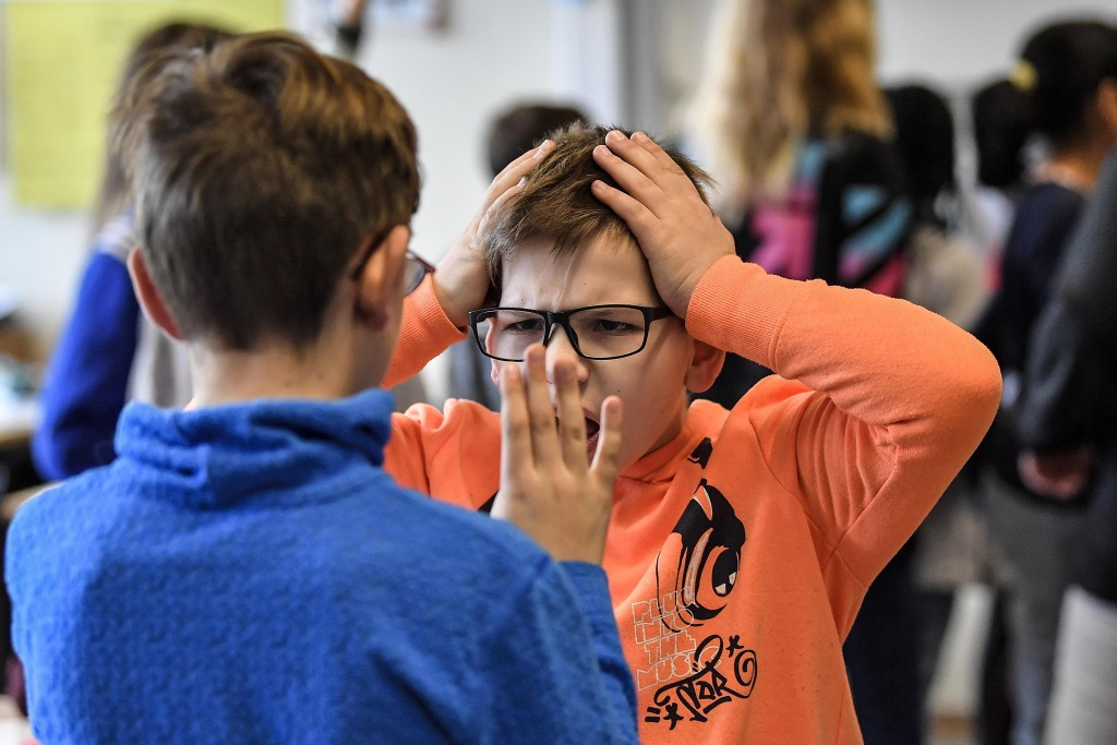 Young pupils during a role play lesson in social media and internet at a comprehensive school in Essen, Germany, Monday, March 18, 2019.  Experts and ...