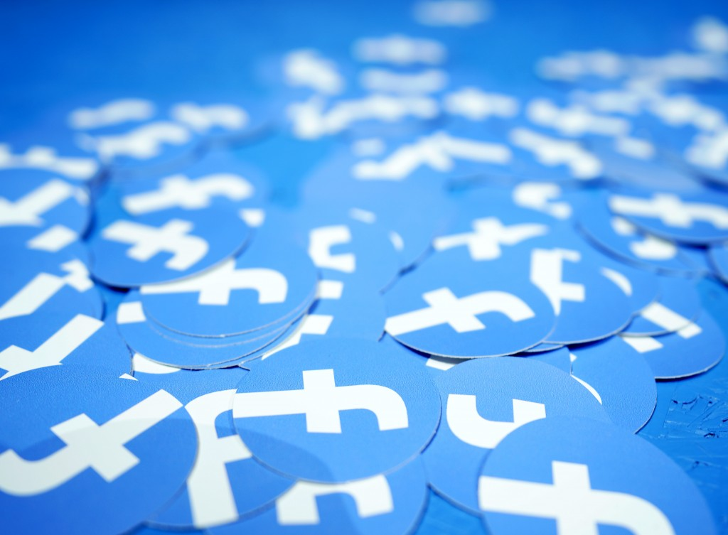FILE - In this April 30, 2019, file photo, Facebook stickers are laid out on a table at F8, Facebook's developer conference in San Jose, Calif. The Bo...
