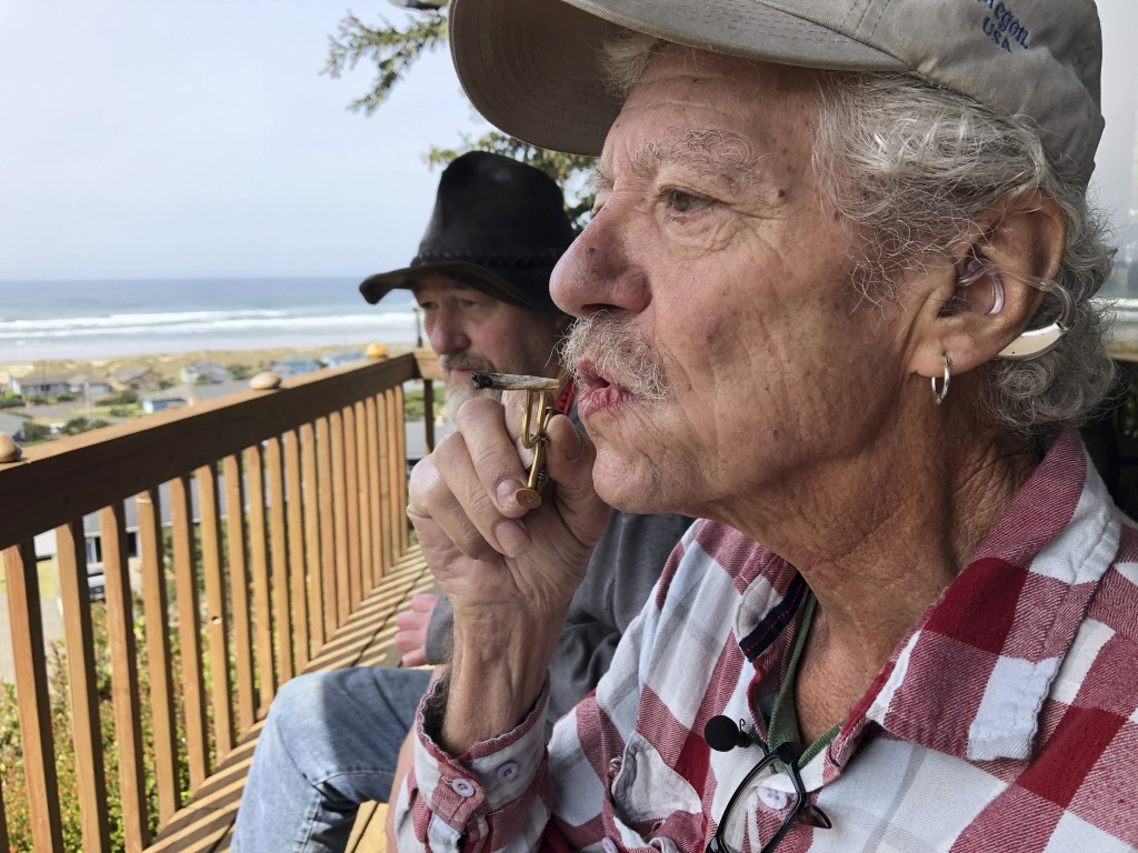 ADVANCE FOR PUBLICATION ON TUESDAY, JUNE 11, AND THEREAFTER - In this April 25, 2019, photo, two-time cancer survivor and medical marijuana cardholder...