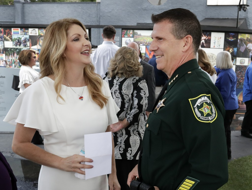 Barbara Poma, left, CEO of the onePulse foundation, talks with Orange County Sheriff John Mina before a news conference to introduce legislation that ...
