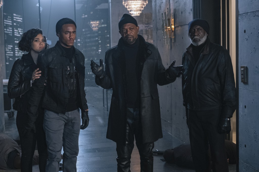 """This image released by Warner Bros. Pictures shows from left, Alexandra Shipp, Jessie Usher, Samuel Jackson and Richard Roundtree in a scene from """"Sha"""