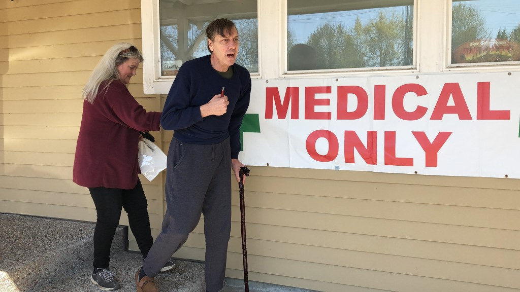 ADVANCE FOR PUBLICATION ON TUESDAY, JUNE 11, AND THEREAFTER - In this April 26, 2019, photo, medical marijuana cardholder Scott Donnelly, assisted by ...