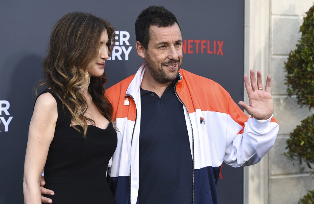 """Jackie Sandler and Adam Sandler arrive at the Los Angeles premiere of """"Murder Mystery,"""" at the Regency Village Theatre, Monday, June 10, 2019, in West"""
