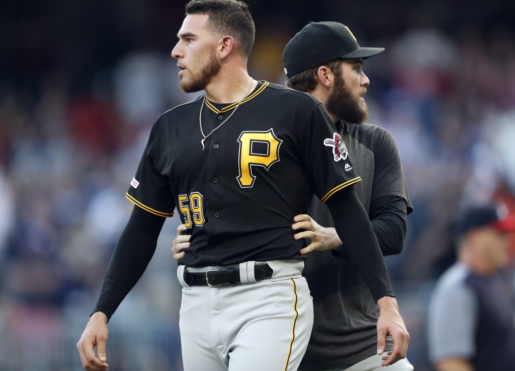 Pittsburgh Pirates starting pitcher Joe Musgrove (59) is lead away from a brief fight with the Atlanta Braves in the first inning of a baseball game M