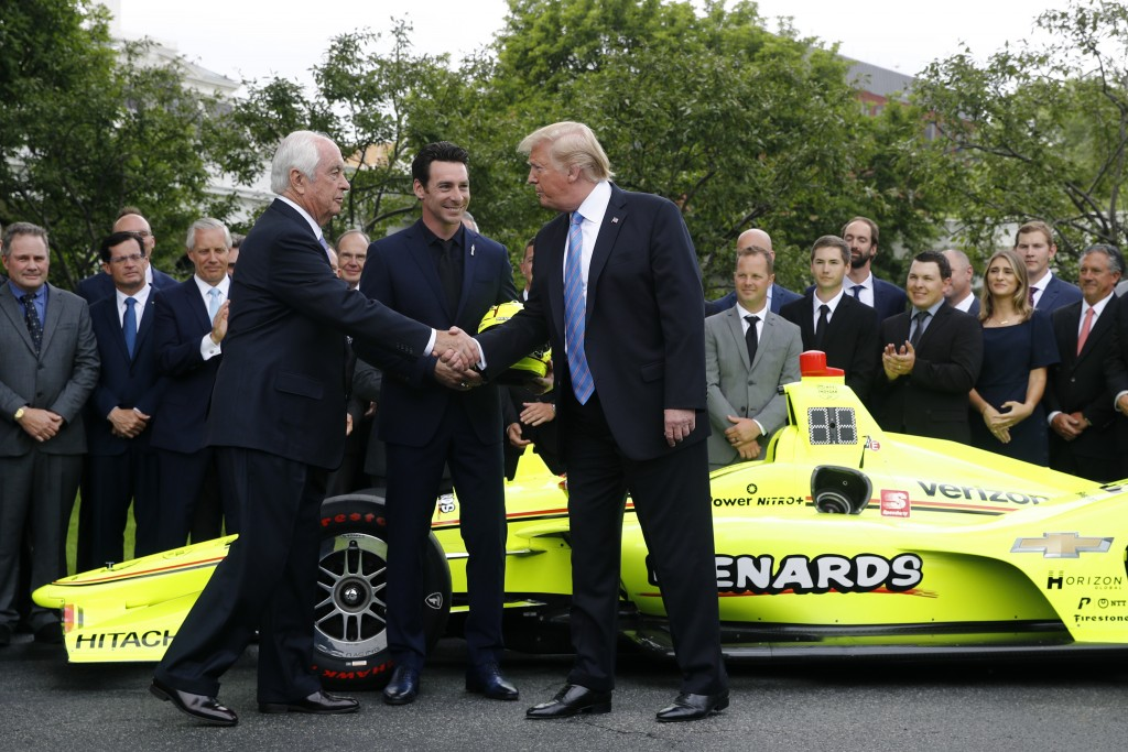 President Donald Trump shakes hands with team owner Roger Penske, left, and driver Simon Pagenaud on the South Lawn at the White House, Monday, June 1
